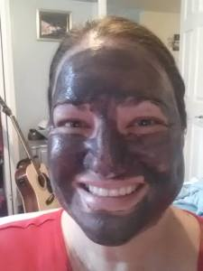 this is me right after putting on the mask.  It starts out black and dries grey.