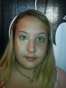 Coryn has dark circles and bags under her eyes.  Notice how she uses concealer in a triangle pattern.
